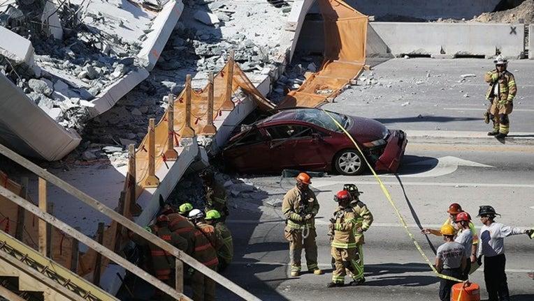 f314b138-GETTY miami bridge collapse FIU_1521460872240.png-402429.jpg