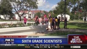 Students collecting environmental data to assist NASA