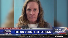 Prison inmate claims guards broke her neck