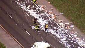 Truck crash leaves mess of mail along I-75