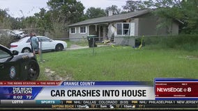 Children nearly hit when car crashes into home
