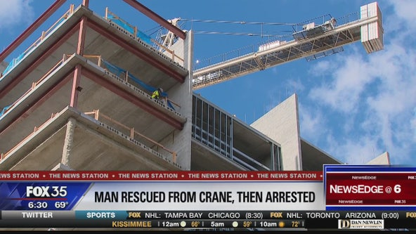 Man rescued from crane before being arrested