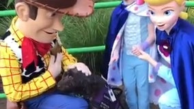Service dog cuddles up to Woody and Bo Peep at Disney in heartwarming video