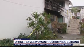 Officer saves woman from burning building
