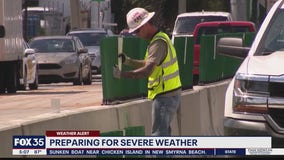 Utility crews and construction workers prepare for storms