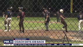 Coach gets job back