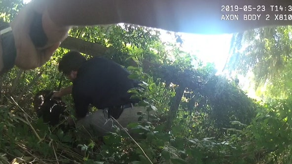 Body cam shows officer pointing a gun at a suspect's head