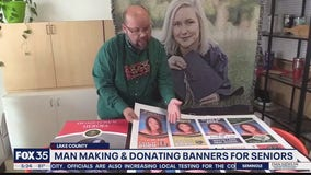 Man making and donating banners for graduating seniors