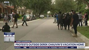 Protesters gather outside Derek Chauvin's Windermere home