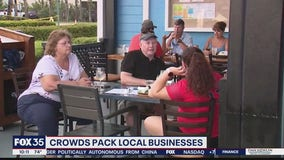 Crowds pack businesses on Space Coast