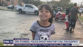 Girl stabbed before police shoot man they call suspect