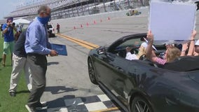 Flagler County graduates drive across Daytona International Speedway finish line, receive diplomas