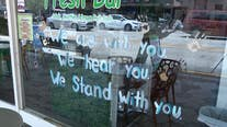 Police officers, business owners join protesters at DeLand rally