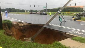 Massive sinkhole opens up in Central Florida, taking down traffic lights with it