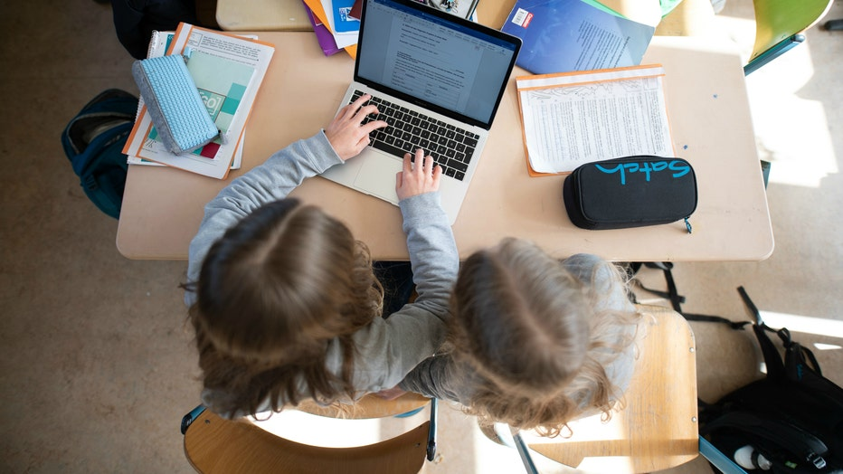 GETTY Girls children students laptops learning