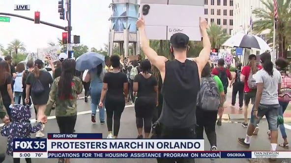 Protesters march on July 4 in Downtown Orlando