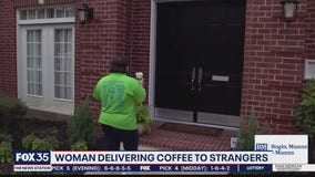 Woman delivering coffee to strangers.