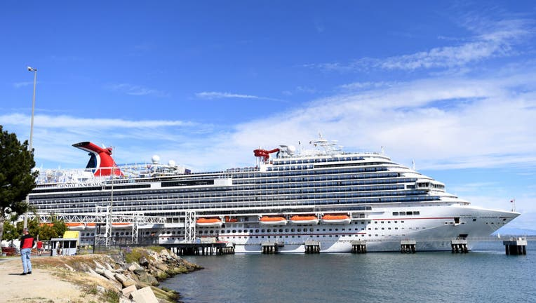 fc695d0d-Carnival Panorama cruise ship delays disembarking as a passenger is tested for medical concerns.