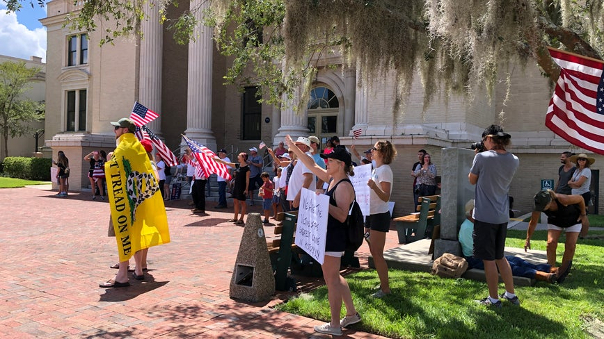 Protesters gather in DeLand calling for end of face mask ordinance