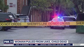 Woman pulled from lake, child found dead inside apartment