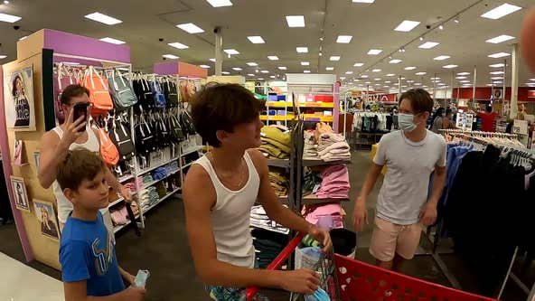 Anti-mask protesters march through Florida Target yelling 'Take off your mask!'