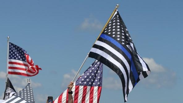 "Florida high school bans football team's police flag after critics deem it ""openly racist"""