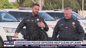 Longwood police officers help clean up lawn