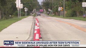 New sidewalk unveiled after teen's petition