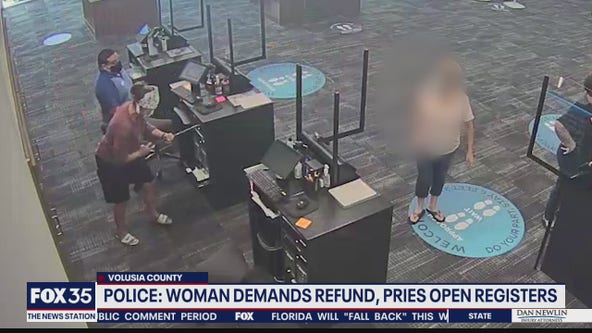 Police say woman pried open register for cable refund