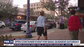 Sanford holding open container Small Business Saturday