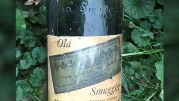 Couple find Prohibition-Era booze hidden behind house walls
