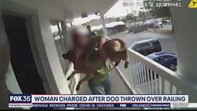 Police say woman threw dog off balcony