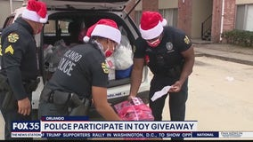 Orlando police officers participate in toy giveaway