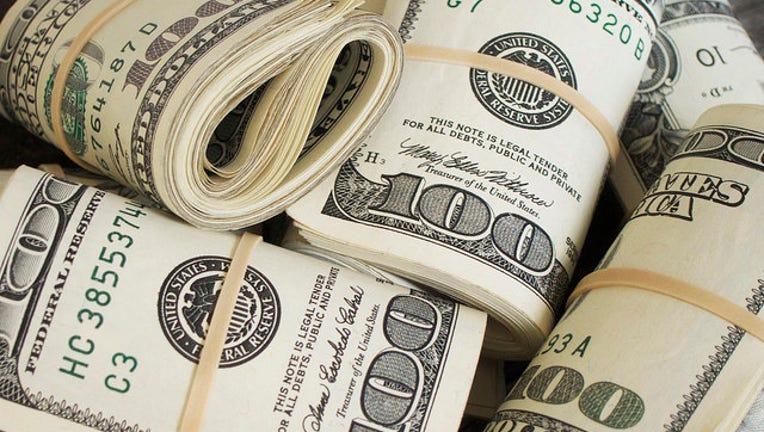 fc586d7e-money-rolls-404023.jpg