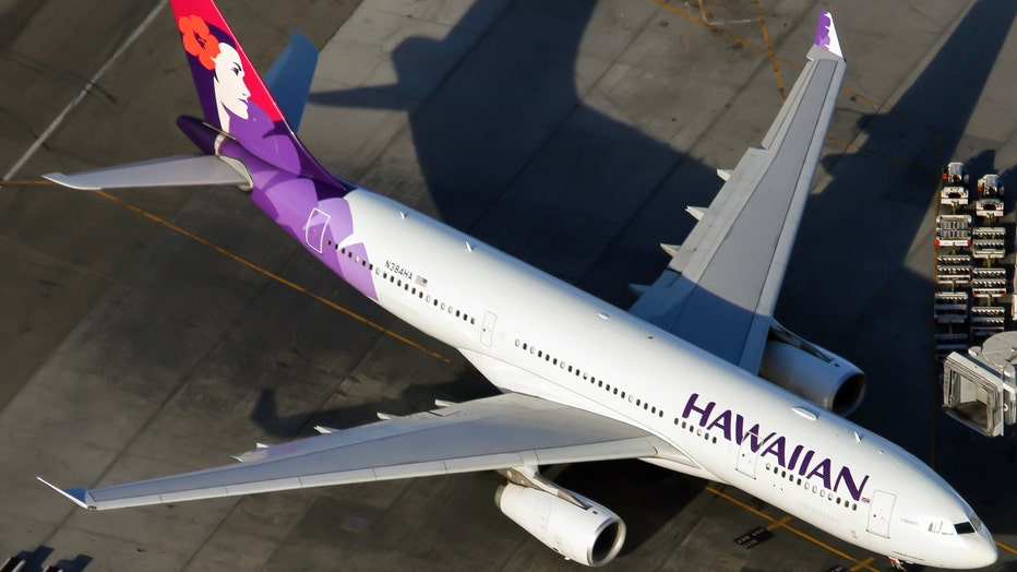 12110104-An Hawaiian Airlines Airbus 330-200 parked at Los Angeles
