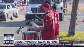 Bucs giving out swag to fans