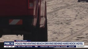 Poles preventing beach driving behind Hard Rock Hotel