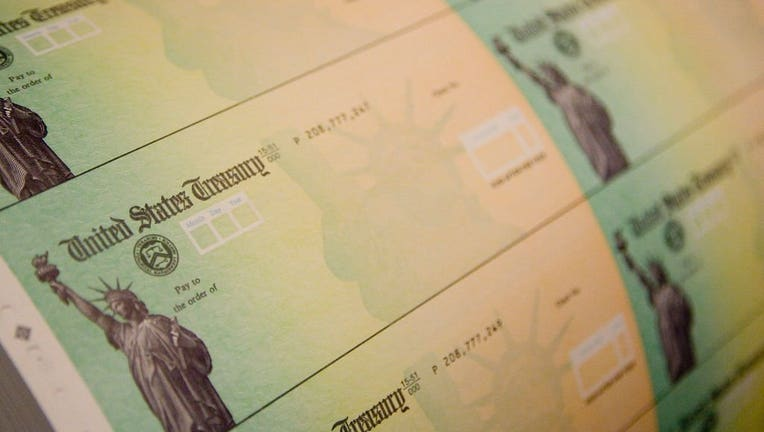Stimulus checks (Getty Images)