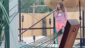 Florida girl caught singing 'Girl on Fire' while cleaning pool goes viral