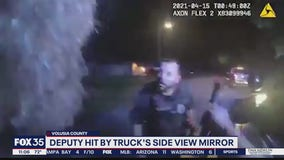 WATCH: Volusia deputy clipped by truck during traffic stop