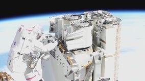 NASA astronauts complete spacewalk to replace solar arrays