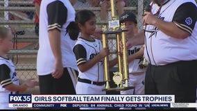 Girls softball team finally gets trophies