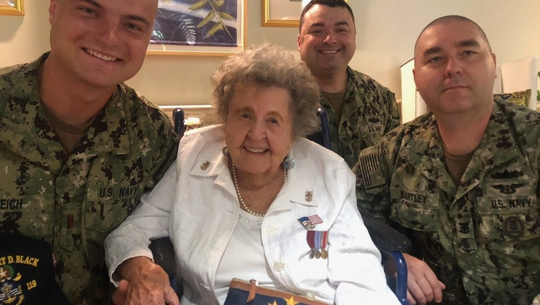 Ima Black with U.S. Navy personnel celebrating her 100th birthday