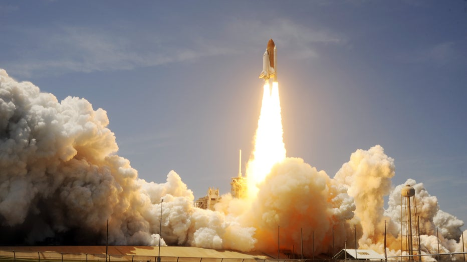 The Space Shuttle Atlantis lifts off May